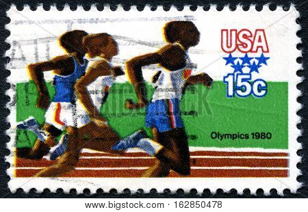 UNITED STATES OF AMERICA - CIRCA 1980: A used postage stamp from the USA illustrating an Athletics scene and commemorating the 1980 Olympic Games circa 1980.