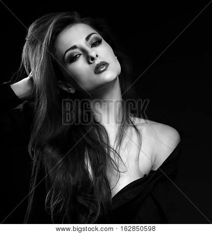Sexy Female Model With Long Brown Hair Posing In Black Shirt On Dark Background. Black And White Por