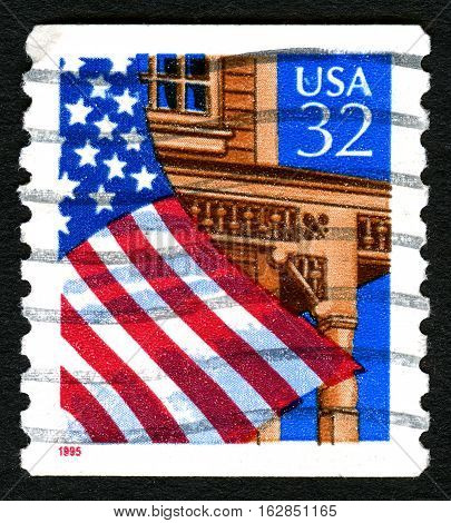 UNITED STATES OF AMERICA - CIRCA 1996: A used postage stamp from the USA depicting an illustration of the stars and stripes flag flying outside a building circa 1996.