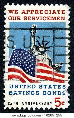 UNITED STATES OF AMERICA - CIRCA 1967: A used postage stamp from the USA commemorating the duty done by Servicemen and protecting freedom and liberty circa 1967.