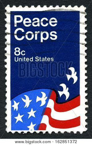 UNITED STATES OF AMERICA - CIRCA 1971: A used postage stamp from the USA celebrating the work of the Peace Corps organization circa 1971.
