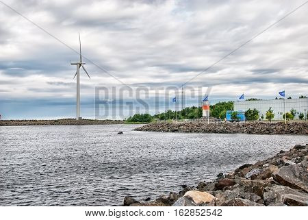 REPOSAARI, FINLAND - JULY 6, 2013: Excursion group on Reposaari Island near lighthouse next to The Gulf of Bothnia. This place is a popular tourist attraction. Also it is a village near Pori Town