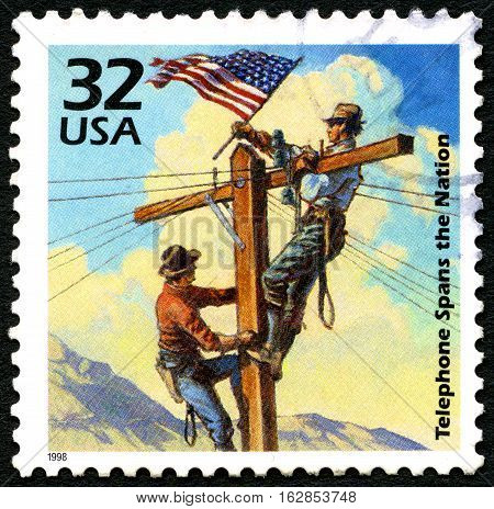 UNITED STATES OF AMERICA - CIRCA 1998: A used postage stamp from the USA comemorating the era when Telephone Spanned the Nation circa 1998.
