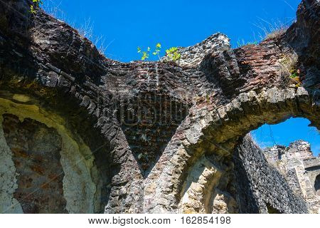 Ancient Stone Wall On Blue Sky Background.