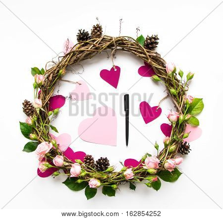 Festive Wreath Of Vines With Decorative Roses And Pink Paper Hearts. Flat Lay, Top View