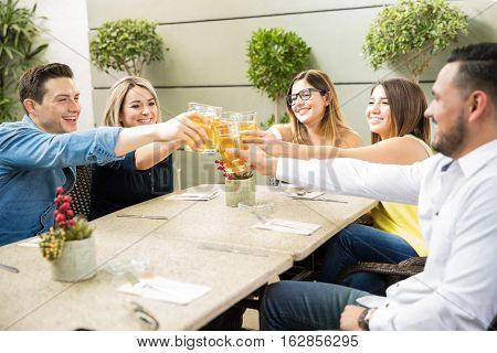 Friends Making A Toast With Beer