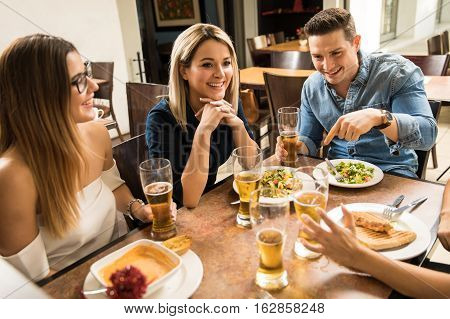 Friends Drinking Beer At A Restaurant