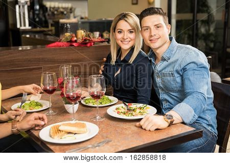 Cute Couple Eating In A Restaurant