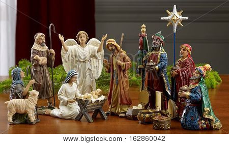 Christmas Manger scene with figurines including Jesus Mary and magi.