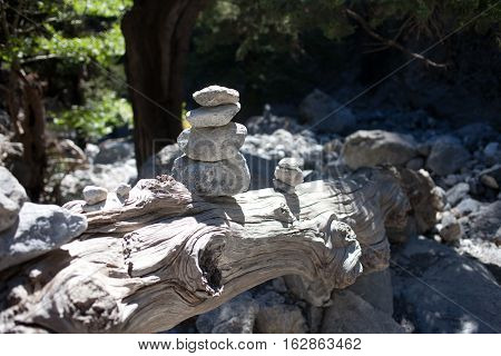 Cairn on the stone in the woods