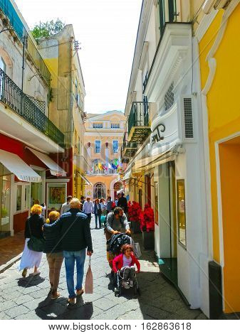Capri, Italy - May 04, 2014: The people going in old center with shopping streets and famous hotels of Capri Island on Capri, Italy - May 04, 2014. The Island of Love , one of the most visited in Europe.