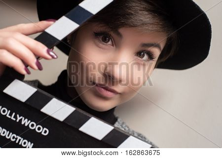 Portrait Of Young Actress Holding A Movie Clapper