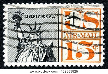 UNITED STATES OF AMERICA - CIRCA 1961: A used postage stamp from the USA depicting an illustration of the Statue of Liberty circa 1961.