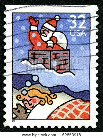 UNITED STATES OF AMERICA - CIRCA 1996: A postage stamp from the USA depicting a festive Christmas illustration of a child dreaming of Santa Claus circa 1996.