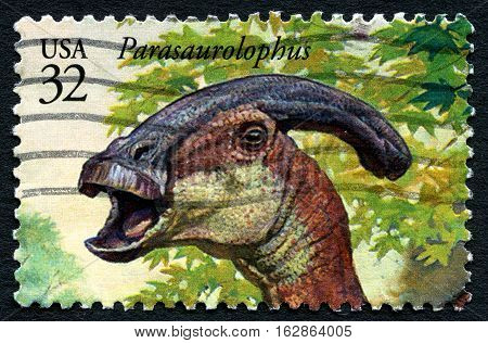 UNITED STATES OF AMERICA - CIRCA 1996: A used postage stamp from the USA depicting a an illustration of a Parasaurolophus dinosaur circa 1996.