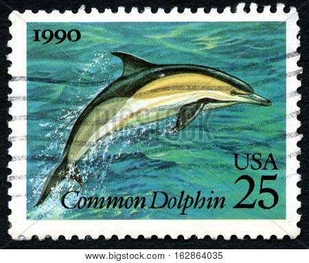 UNITED STATES OF AMERICA - CIRCA 1990: A used postage stamp from the USA depicting an illustration of a Dolphin circa 1990.