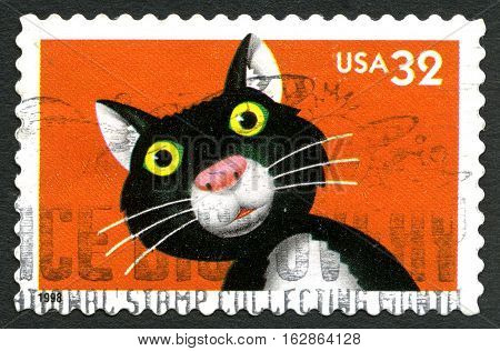 UNITED STATES OF AMERICA - CIRCA 1998 - A used postage stamp from the USA depicting an illustration of a black and white cat circa 1998.