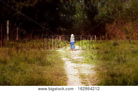 Little Girl On The Threshold Of A Dark Forest Horror Styled