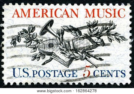 UNITED STATES OF AMERICA - CIRCA 1964: A used postage stamp from the USA illustrating a Lute Horn Laurel Oak and Music Score circa 1964.