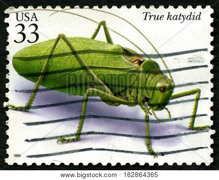 UNITED STATES OF AMERICA - CIRCA 1999: A used postage stamp from the USA depicting an illustration of a True Katydid insect circa 1999.