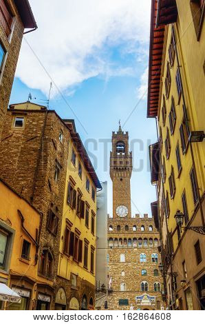 Torre Arnolfo And Palazzo Vecchio In Florence With Unidentified People. The Palace Was The Seat Of T
