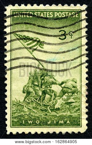UNITED STATES OF AMERICA - CIRCA 1945: A used postage stamp from the USA depicting an illustration of the famous scene of the raising of the US flag at Iwo Jima circa 1945.