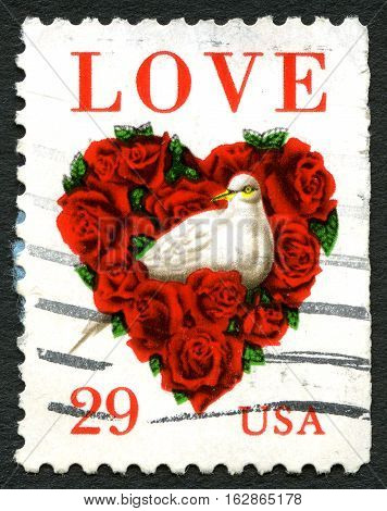 UNITED STATES OF AMERICA - CIRCA 1994: A used postage stamp from the USA celebrating the concept of love with an illustration of a dove surrounded by red roses in the shape of a heart circa 1994.