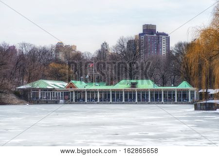 Frozen pond and The Boat House in Central Park in New York City