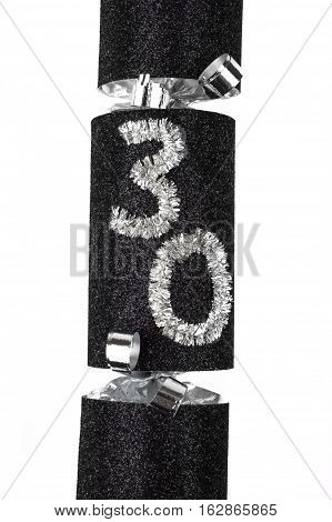 A shot of a 30th Birthday or Anniversary Cracker also known as a Bon Bon. A traditional cracker consists of a cardboard tube wrapped in a brightly decorated twist of paper with a gift in the central chamber.