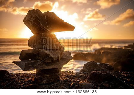 Cairn or stack of rocks silhouette at sunset