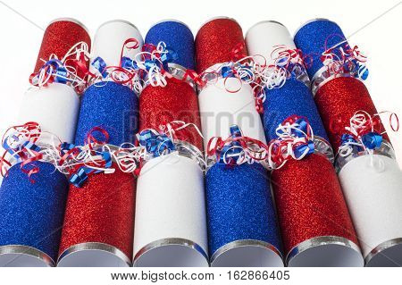 A shot of a set of Crackers or otherwise known as a Bon Bons. A traditional cracker consists of a cardboard tube wrapped in a brightly decorated twist of paper with a gift in the central chamber.