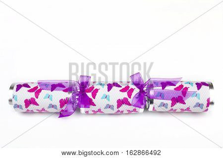 A shot of a Cracker or otherwise known as a Bon Bon. A traditional cracker consists of a cardboard tube wrapped in a brightly decorated twist of paper with a gift in the central chamber.