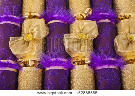 A studio shot of Christmas Crackers or otherwise known as Bon Bons. A cracker consists of a cardboard tube wrapped in a brightly decorated twist of paper with a gift in the central chamber.