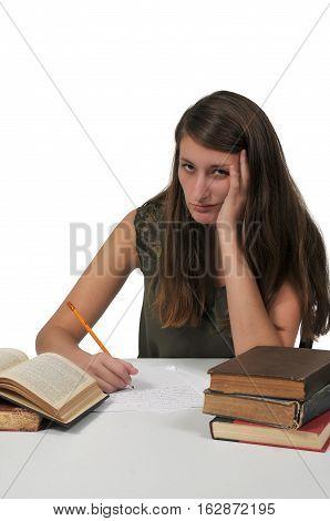 Beautiful young woman doing her school homework