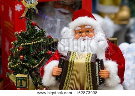 Santa Claus with an accordion. Father Frost Father Christmas.