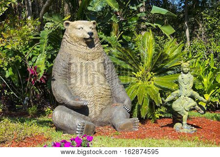 Gotha Florida - December 22nd 2016: Brown Bear sitting in garden at Christmas time Gotha Florida - December 22nd 2016