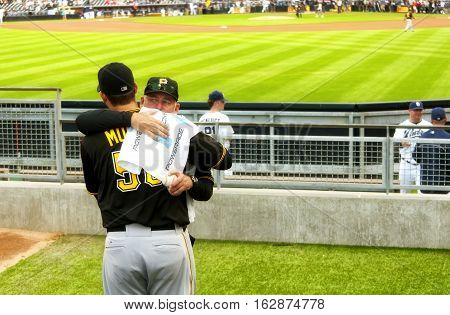 June 3 2014. San Diego California. Charlie Morton relief pitcher for the Pittsburgh Pirates hugging the pitching coach in the bullpen in Petco field in San Diego California.