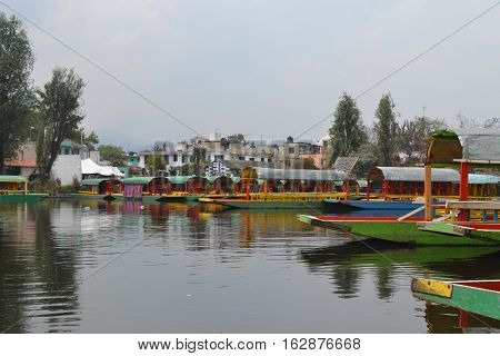 Xochimilco, Mexico is known as the Venice of the Americas. Using boats called trajineras to maneuver the canals and waterways