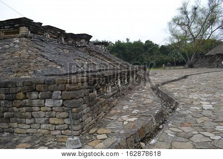 Ruins and drainage canal at the pre-Columbian archeological site El Tajin in Papantla, Veracruz, Mexico