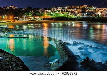 Sydney, Australia - May 28, 2016: Dusk at Bronte Beach and Baths. High resolution, long exposure image of the tidal wave movements.