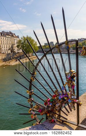 Metal Grid With Love Locks On The Ile De La Cite In Paris, France