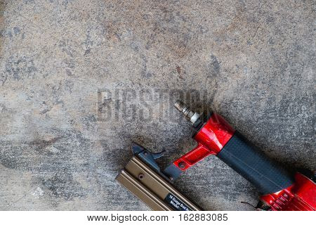 air gun on cement background, Industrial tool