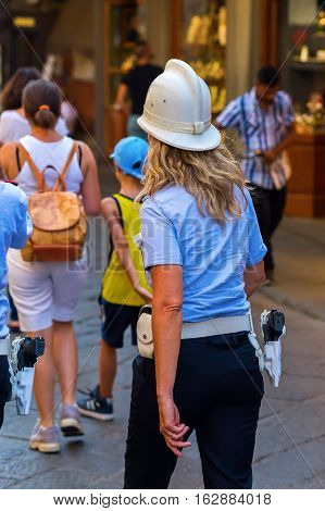 Florence Italy - July 04 2016: unidentified policewoman on the Ponte Vecchio in Florence. In medieval time Florence was the center of European trade and one of the wealthiest cities
