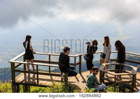CHIANG MAI THAILAND - 06 NOVEMBER 2016 - Unidentified tourists enjoy taking their portrait photograph with nature background at Kew Mae Pan panoramic vantage point.