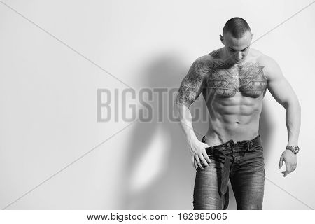 Attractive Man Isolated On Gray Background