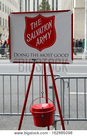NEW YORK - DECEMBER 15, 2016: Salvation Army red kettle for collections in midtown Manhattan. This Christian organization is known for its charity work, operating in 126 countries