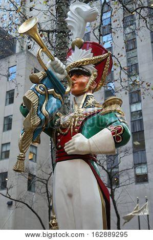 NEW YORK CITY- DECEMBER 15, 2016: Wooden toy soldier bugler Christmas decoration at the Rockefeller Center in Midtown Manhattan