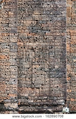 Carved brick wall from the East Mebon temple in Siem Reap Cambodia.