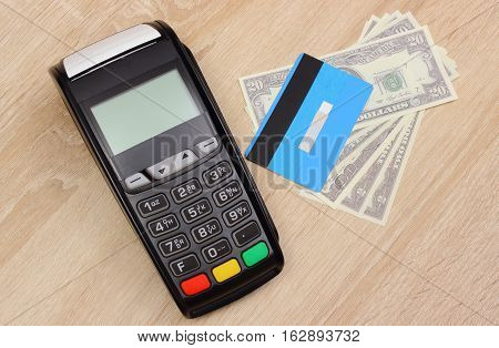 Payment Terminal With Credit Card And Money On Desk, Finance Concept