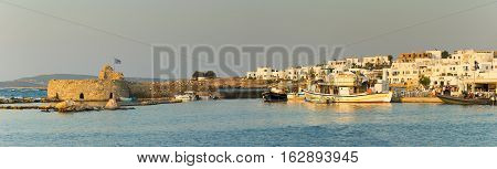 Paros, Greece 5 August 2016. Panoramic view of Naoussa local village with Kastelli castle.